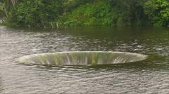 HD Overflow Water Funnel in Lake Stock Footage