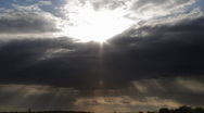 Stock Video Footage of Ominous Cloud Timelapse with Sun Rays