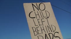 No child left behind sign at protest Stock Footage