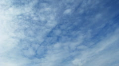 Time lapse of blue sky with fast moving clouds. Loopable Stock Footage