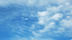 Time lapse of blue sky with fast moving clouds - stock footage
