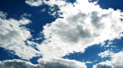 Time lapse of blue sky with fast moving clouds with sun Stock Footage