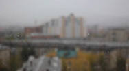 Snow with defocused building background Stock Footage