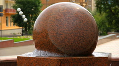 Fountain. Rotating stone sphere in bowl - stock footage