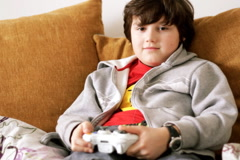 Young boy playing videogames Stock Footage