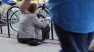 Stock Video Footage of Older woman sitting at curb texting on her cell phone - 2