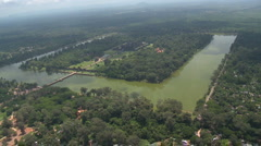 Aerial of Angkor Wat including the square moat and the long presession way an Stock Footage