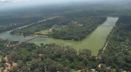 Stock Video Footage of Aerial of Angkor Wat including the square moat and the long presession way an