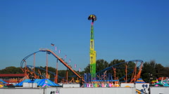 Fun at the Fair - G-Force Ride and Rollercoaster Stock Footage