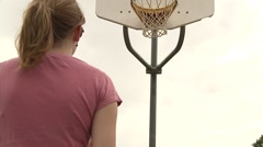 Female basketball shot pan up Stock Footage