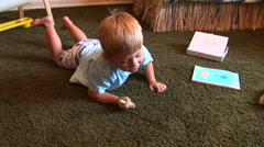 Young two-year-old writing with chalk on board Stock Footage