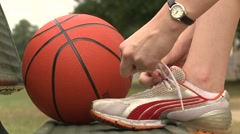 Tie shoe grab basketball Stock Footage