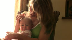 Close up of mother and new baby Stock Footage