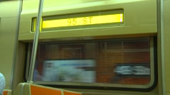 On subway train, signage inside and out Stock Footage