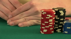 Hands betting chips while holding playing cards - stock footage