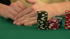 Hands shuffling a deck of cards on poker table - stock footage
