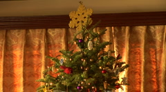 Decorated Christmas tree with wrapped presents underneath Stock Footage