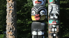 Stanley Park Totem Poles in Vancouver BC, Canada - stock footage