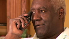 Portrait of senior man indoors talking on cell phone - stock footage