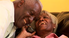 Portrait of senior couple talking together on cell phone Stock Footage
