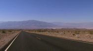 Car driving in Death Valley Stock Footage