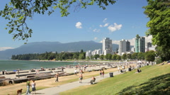 People enjoying First Beach / Sunset Beach  in Vancouver British Columbia - stock footage