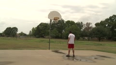 Male dolly basketball shoot slow mow Stock Footage
