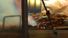 Food, kebabs BBQ-ing over open flame, night Stock Footage
