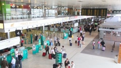 People walking in Dublin Airport interior in Dublin, Ireland. Stock Footage
