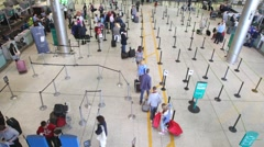 People passing check-in desks in Dublin Airport, Ireland. Stock Footage