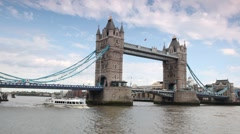 Excursion boat slowly going under magnificent Tower Bridge in London Stock Footage