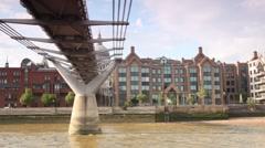 View from excursion boat going slowly under London Millennium Footbridge Stock Footage