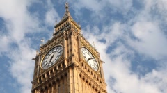 Big Ben in front of running clouds in morning time Stock Footage