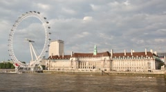 View on giant Ferris wheel called London Eye and River Thames Stock Footage