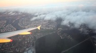 Stock Video Footage of airplane flying slowly over Moscow city