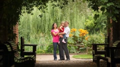 Family carrying one kid hugging embracing and kissing her - stock footage