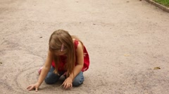 Girl turn and whirl while playing with sand Stock Footage