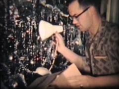 Opening Christmas Gifts (1962 Vintage 8mm film) Stock Footage