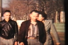 Family Poses Outside New House (1958 Vintage 8mm film) - stock footage
