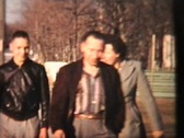 Stock Video Footage of Family Poses Outside New House (1958 Vintage 8mm film)