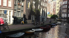 Amsterdam with Boats and Homes along Canal Stock Footage