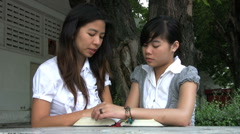 Teacher And Asian Student - Low Angle Stock Footage