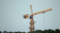 Construction site with working tower crane Stock Footage