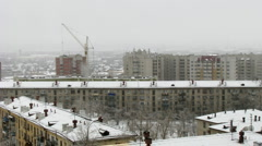Time lapse of cityscape with falling snow Stock Footage