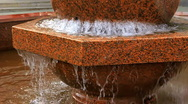 Fountain. Rotating stone sphere in bowl Stock Footage