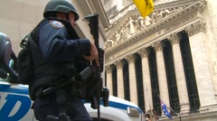 Crime and justice, police, heavily armed police officer and stock exchange Stock Footage