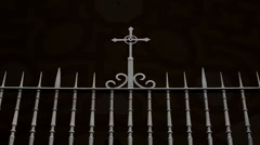 Iron cross on grille covered by shadow Stock Footage