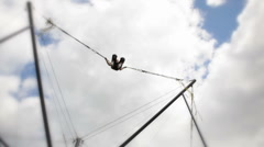 Young Boy Bungee Jumping, Low Angle View Stock Footage