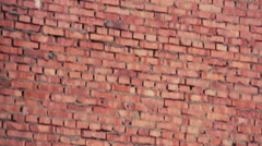 Red old brick's wall running up Stock Footage