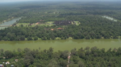 Aerial overview of entire Angkor Wat temple complex including the square moat Stock Footage
